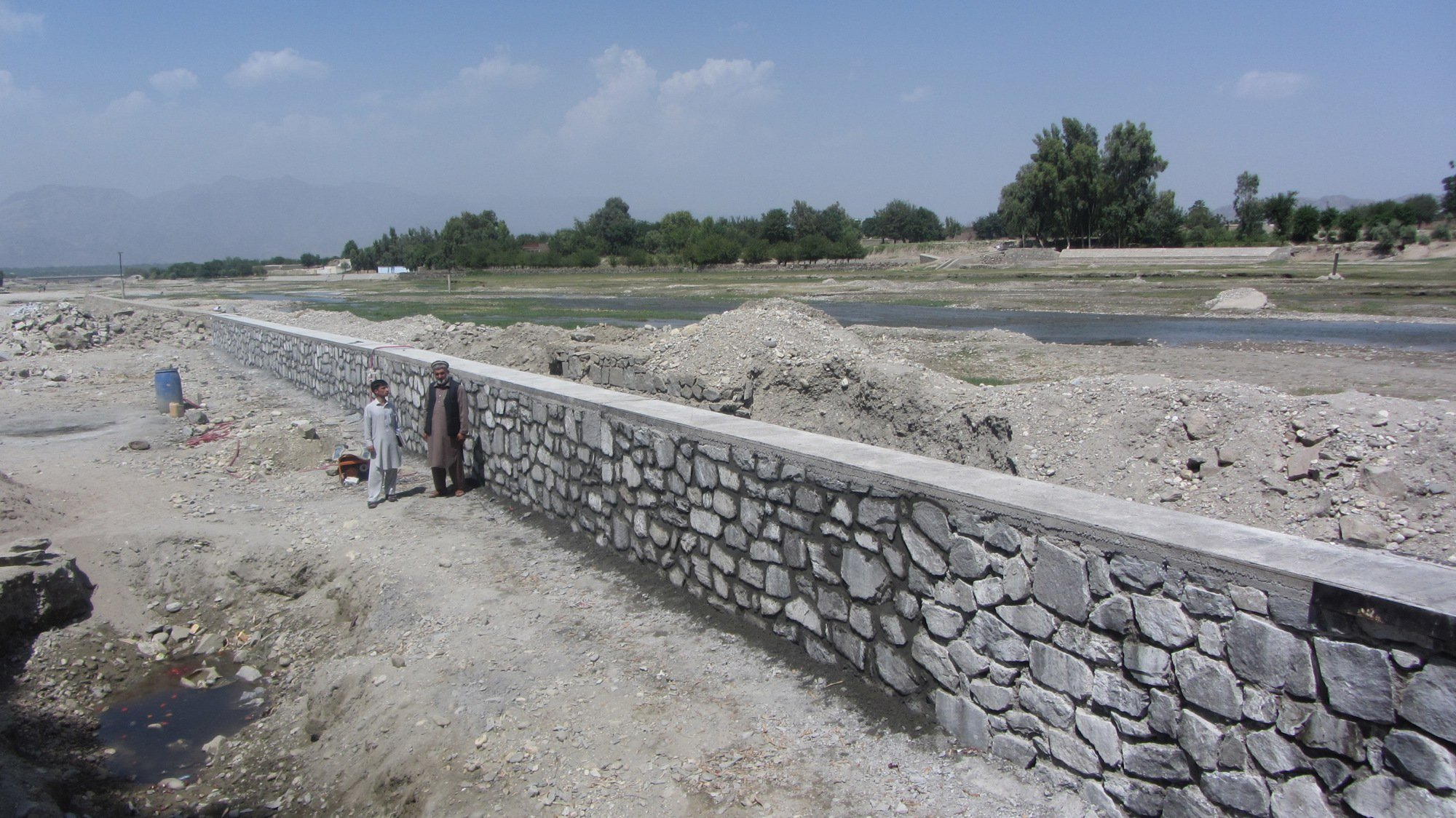 Flood protection wall surrounds the village